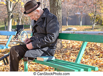 Retired disabled man in an autumn park - Retired disabled...