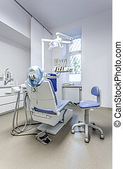Dental equipment - Vertical view of a seat and tools in...