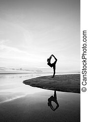 Yoga - Silhouette woman with yoga posure on the beach at...