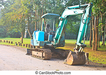 Back Hoe construction machinery equipment standing in...