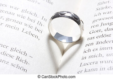 heart in a book by a ring