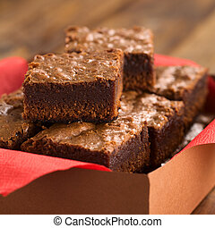 Brownies - Freshly baked brownies in a brown paper box with...