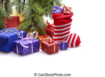 Christmas gifts - gift boxes with stocking under Christmas...