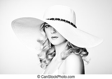 Fashion photo of young magnificent woman in hat. Girl...