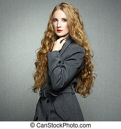 Portrait of young woman in autumn coat. Fashion photo