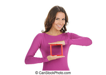 Women with picture frame. Beautiful young women holding a picture frame and smiling while isolated on white