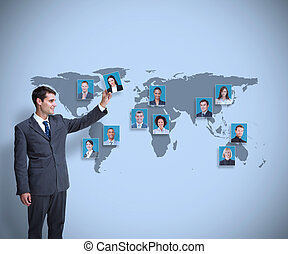 Stylish businessman holding profile picture on map...