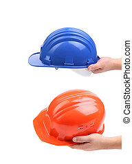 Two hands holding hard hats. Whole background.