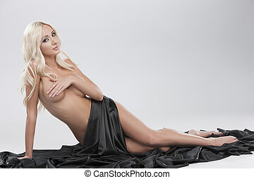 Naked and beautiful. Beautiful naked woman covering body...