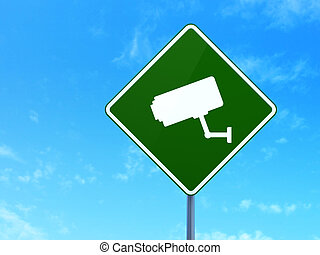 Privacy concept: Cctv Camera on road sign background -...