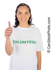 Pretty volunteer woman with thumb up