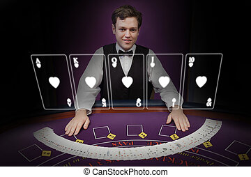 Picture of croupier standing behind holographic cards behind...