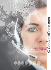 Pretty businesswoman using futuristic interface hologram...
