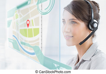 Happy call center employee using futuristic street map...