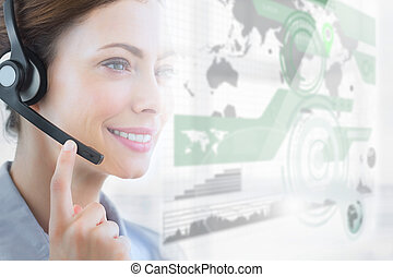 Smiling call center employee looking at futuristic interface...