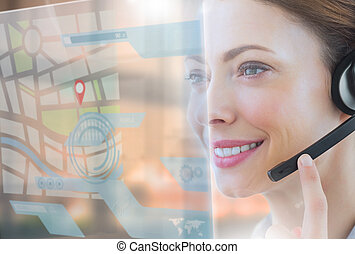 Happy call center employee looking at futuristic interface...