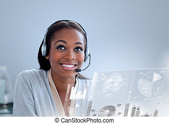 Cheerful woman with headset using futuristic interface...