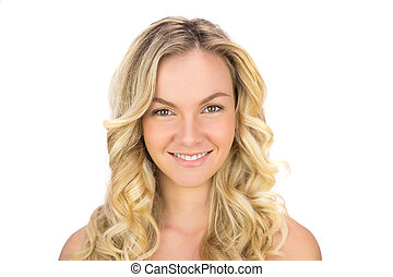 Smiling curly haired blonde posing on white background