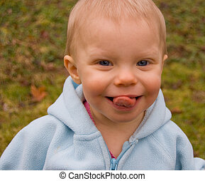 Toddler Girl With Tongue Sticking Out - Photo of an adorable...