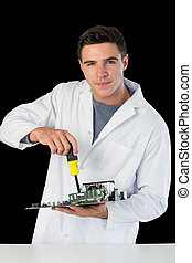 Attractive smiling computer engineer repairing hardware at...