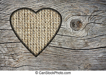 Background with a hole in the shape of heart and old wood board