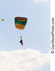parachuter flying against the sky
