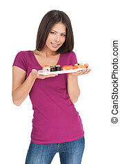 Beauty with sushi. Beautiful mixed race woman holding a plate of sushi while standing isolated on white