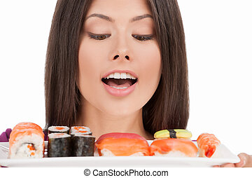 Fresh sushi. Portrait of beautiful mixed race woman holding a plate of sushi while isolated on white