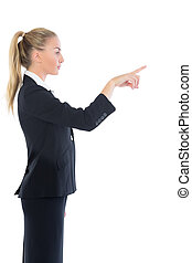 Profile view of attractive blonde businesswoman pointing on...