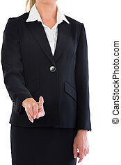 Mid section of blonde businesswoman pointing at camera on...