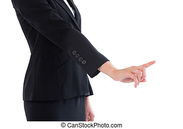 Mid section of young businesswoman pointing on white...