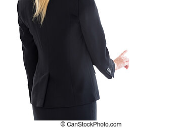 Mid section of blonde businesswoman pointing on white...