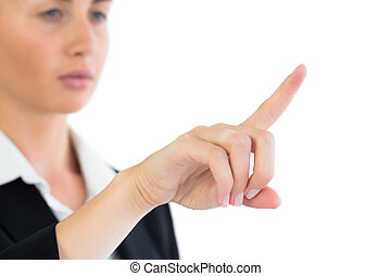 Close up of attractive business woman pointing on white...