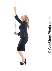 Blonde young businesswoman pulling a chain on white...