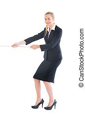 Cheerful blonde businesswoman pulling a rope on white...