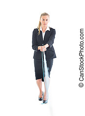 Serious young businesswoman using a hose looking at camera