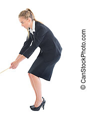Concentrating young businesswoman pulling a rope on white...