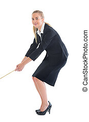 Smiling ponytailed business woman pulling a rope on white...