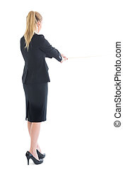 Rear view of standing business woman pulling a rope on white...