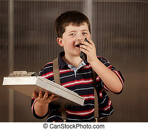 Little boy in adult clothes on cell phone