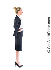 Profile view of attractive serious businesswoman on white...