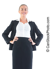 Low angle profile view of cute businesswoman posing smiling...