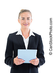 Front view of happy young businesswoman holding her tablet