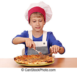 hungry boy chef eat pizza