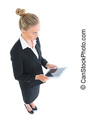 High angle side view of smart businesswoman using her tablet