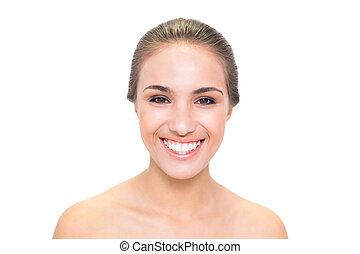 Cheerful brunette woman looking at camera on white...