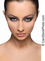 Beautiful make-up. Portrait of confident young women with make-up looking at camera while isolated on white