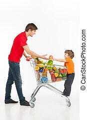 Man and child shopping. Cheerful young man and little boy...