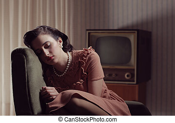 Vintage woman - Young woman sleeping on armchair, 1950...