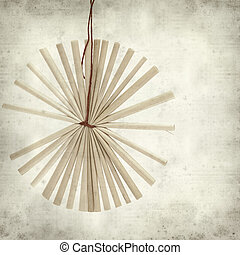 textured old paper background with traditional straw...
